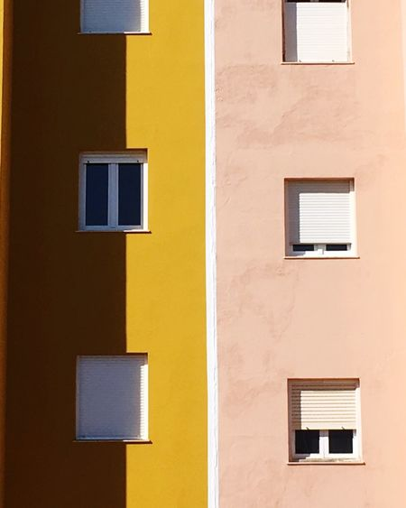 Architecture Building Exterior Window Built Structure Yellow Full Frame No People Minimal Artphoto Minimalobsession Architecture Backgrounds Minimalist Photography  Shadow Windows Architectural Feature Architectural Detail The Architect - 2017 EyeEm Awards Paint The Town Yellow The Graphic City Colour Your Horizn