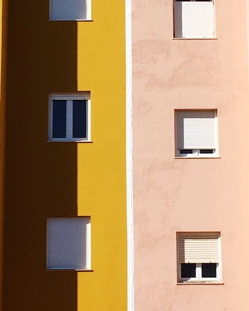 Architecture Building Exterior Window Built Structure Yellow Full Frame No People Minimal Artphoto Minimalobsession Architecture Backgrounds Minimalist Photography  Shadow Windows Architectural Feature Architectural Detail The Architect - 2017 EyeEm Awards Paint The Town Yellow The Graphic City Colour Your Horizn Creative Space #urbanana: The Urban Playground