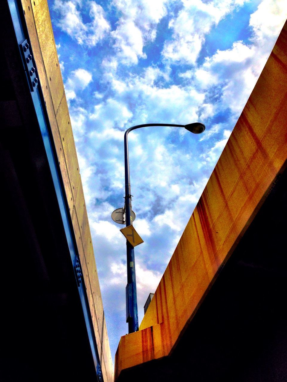 low angle view, sky, cloud - sky, built structure, architecture, street light, day, outdoors, no people, building exterior