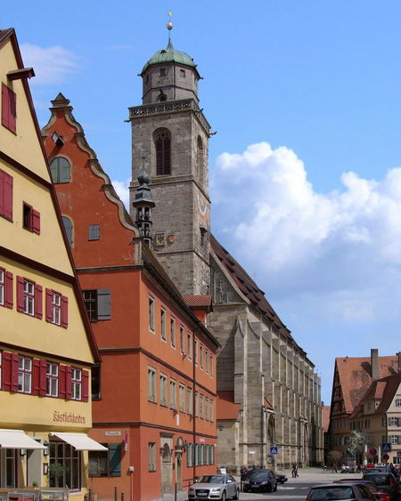 Street scene in Dinkelsbühl, Germany Dinkelsbuhl Architecture Bell Tower Blue Building Exterior Built Structure City Clock Clock Tower Day Germany No People Outdoors Place Of Worship Religion Sky Spirituality Street Tower Town