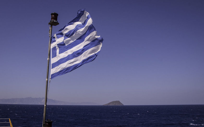 Greek flag blowing in the wind