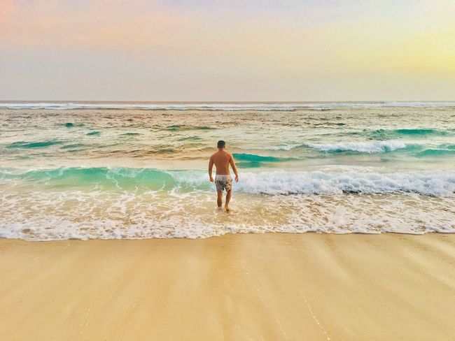 Sea Beach Water Land Motion Horizon Over Water Sky Real People Wave Vacations One Person Horizon Shirtless Holiday Sand Beauty In Nature Trip Nature Leisure Activity Outdoors The Great Outdoors - 2018 EyeEm Awards