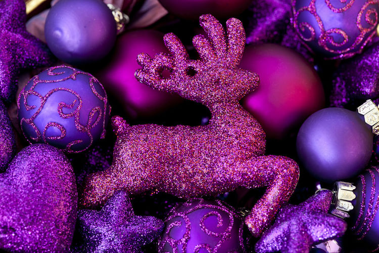 Box full of pink and purple glittering Christmas decoration with reindeer Christmas Festive Season Glitter Pink Reindeer Shiny Xmas Xmas Decorations Christmas Decoration Close-up Colorful Festive Decor Fragility Full Frame Glamour Indoors  Large Group Of Objects No People Ornaments Purple Season  Seasonal Decorations Shimmering Studio Shot