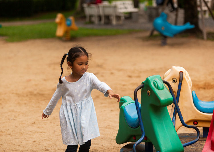 Cute girl playing at playground