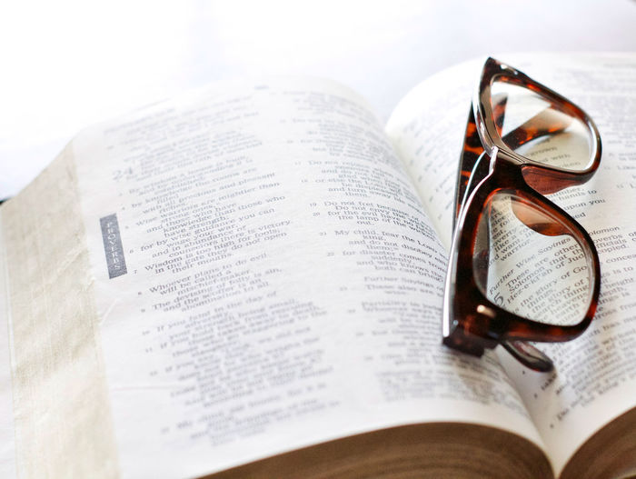 Bible Verses Glasses Reading Glasses Book Close-up No People Open Page Spirituality Still Life Text Tortoise Shell Color