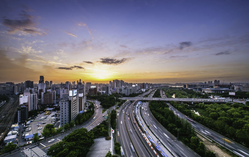 Singil District, Seoul, South Korea skyline at night. Architecture Building Building Exterior Built Structure Car City City Life Cityscape Cloud - Sky High Angle View Highway Land Vehicle Mode Of Transportation Modern Multiple Lane Highway Nature No People Office Building Exterior Outdoors Road Sky Skyscraper Street Sunset Transportation