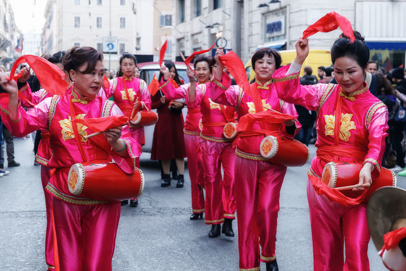 Rome, Italy - January 28, 2017: Chinese women in traditional dress, play and dance through the streets of the capital, during the procession celebrating the Chinese New Year in the year of the rooster. Adult Bongo Drum Chinese Culture Chinese Instruments Chinese Lady Chinese New Year Cymbals Day Outdoors Percussion Instrument Play And Dance Real People Traditional Clothing Women