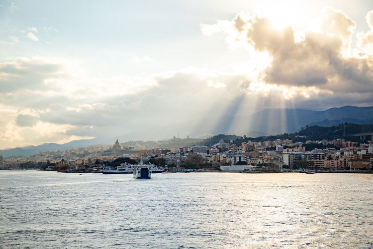 Messina Italy Sicily Ferry Sea Sky Cloud - Sky Architecture Water Building Exterior Built Structure Nautical Vessel Waterfront Nature Day Mountain Beauty In Nature Transportation Building City Scenics - Nature No People Sunlight Outdoors Cityscape Sailboat