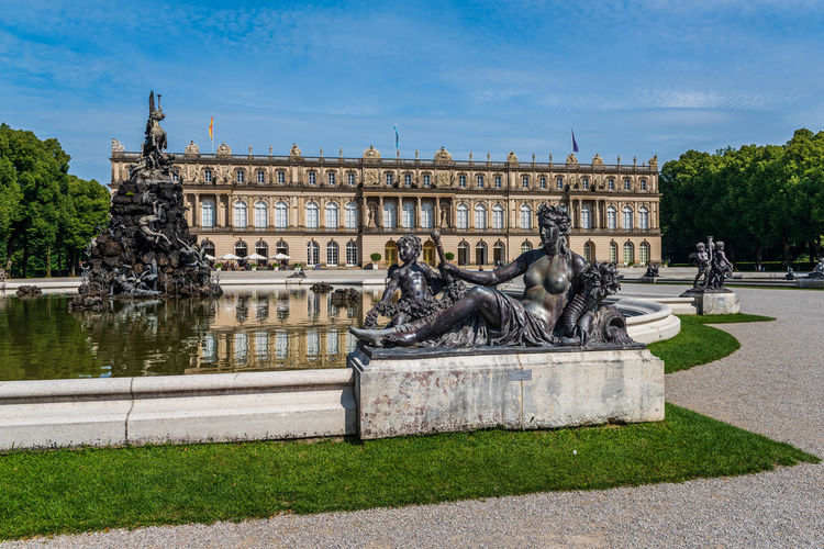 Statue at fountain with castle in background