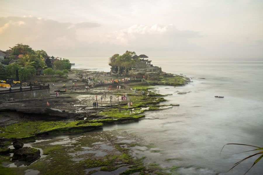 Tanah Lot Temple, Bali, Indonesia. Bali INDONESIA Tanah Lot Temple Traveling Architecture Beauty In Nature Building Exterior Built Structure Cloud - Sky Day Nature Outdoors Plant Scenics - Nature Sea Sky Tranquil Scene Tranquility Travel Destinations Water