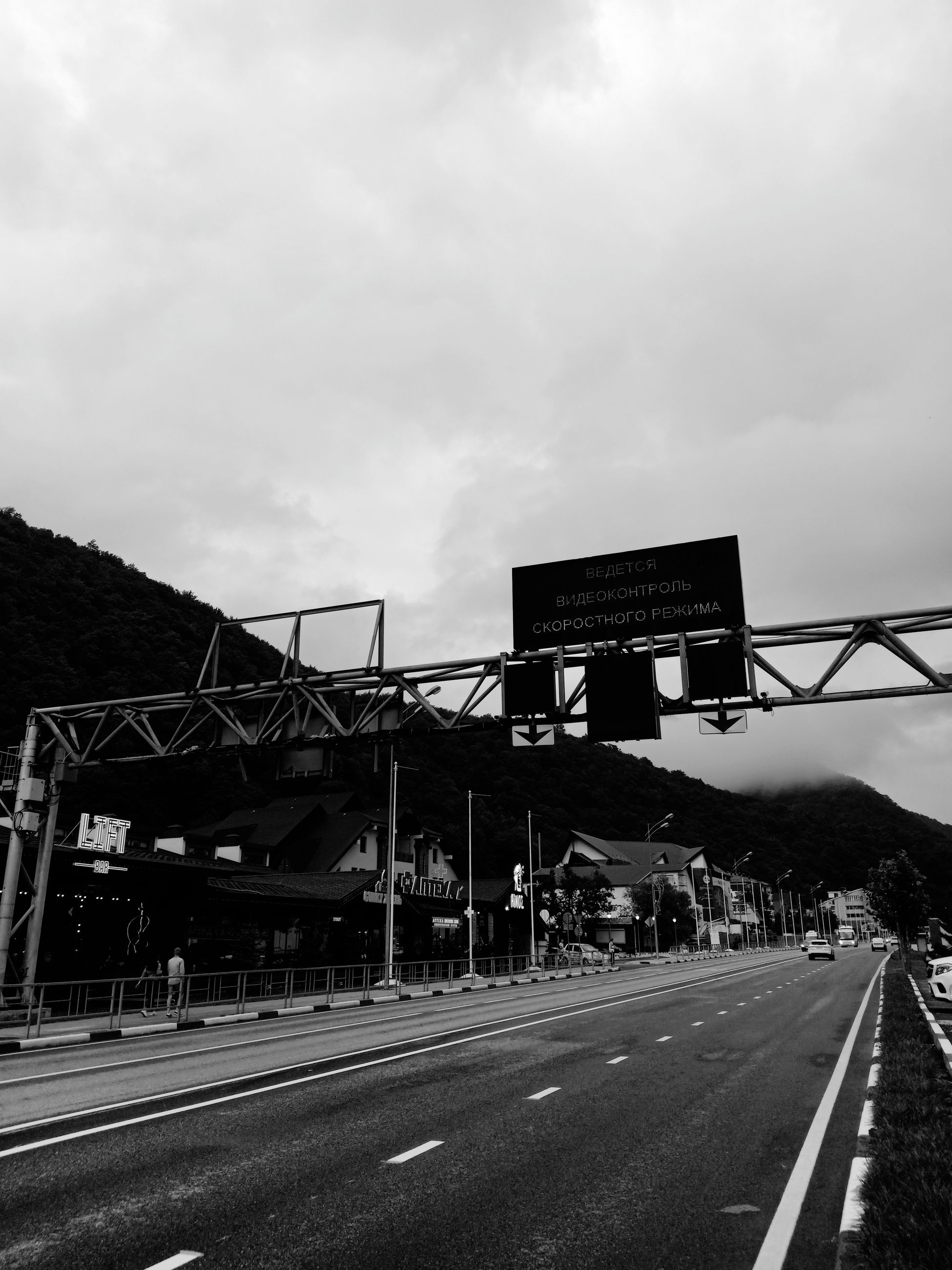 road, sky, transportation, sign, cloud - sky, symbol, nature, architecture, direction, built structure, the way forward, marking, road marking, mode of transportation, no people, outdoors, communication, bridge, connection, day, bridge - man made structure