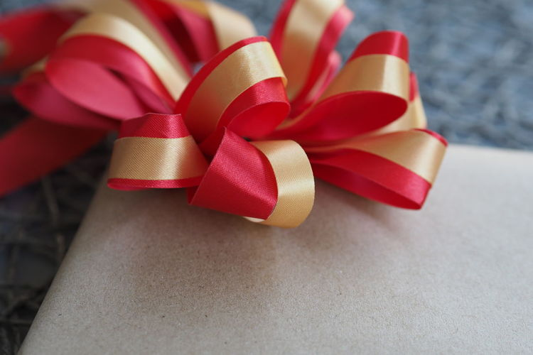 Ribbon Ribbon - Sewing Item Close-up Gift Gift Box Present Holiday - Event Holiday Moments Giving Concept Birthday Backgrounds Ideas Love Happy Day Bow Gray Background Christmas Decorative Decoration Valentine's Day  Valentine Special Moment Tied Bow Paper Celebration Surprise Wrapped Tied Up Red High Angle View