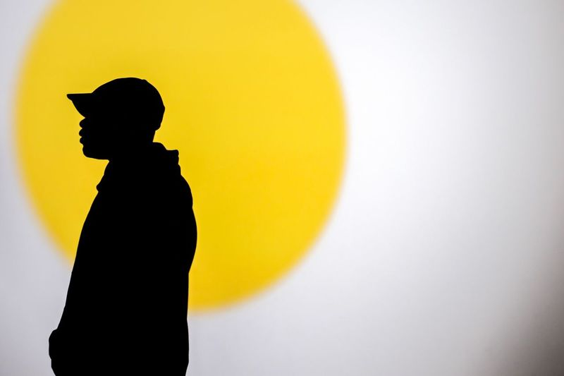 Close-up of silhouette boy against white background