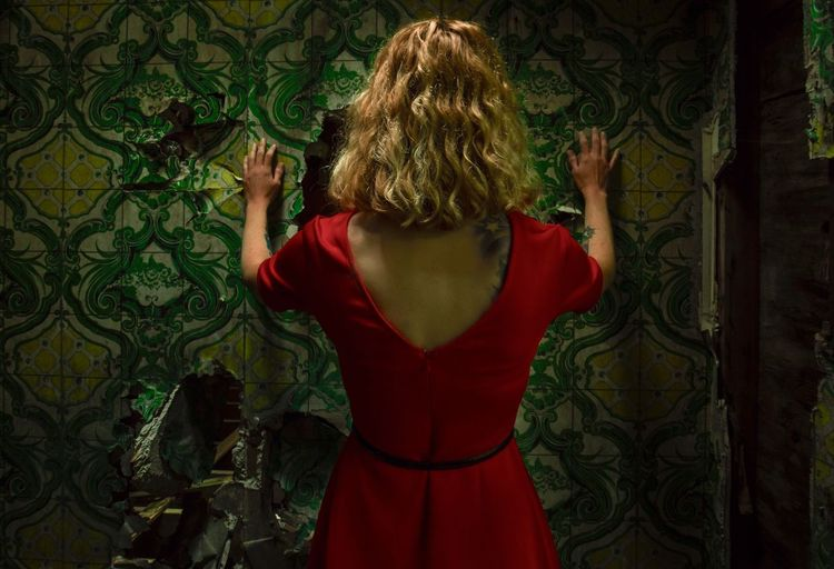 Rear View Of Woman Wearing Red Dress While Standing In Abandoned House