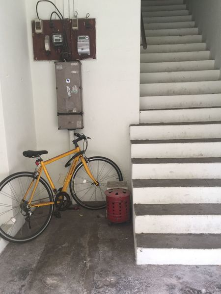 On or up Concrete Stairs Yellow Bicycle EyeEm Selects Bicycle Transportation No People Architecture Land Vehicle Built Structure Stationary Staircase Mode Of Transportation Building Entrance Power Supply Wall - Building Feature