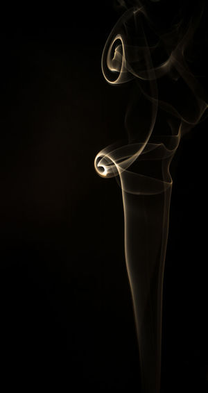 Abstract Black Background Burning Fire Smoke - Physical Structure Smoking Studio Shot Swirl