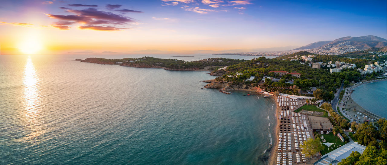 Famous Astir Beach in the south of Athens, Vouliagmeni, during sunset Greek Mediterranean  Travel Vacations Vouliagmeni Aerial Athens Bay Beach Elevated View Glyfada Greece High Angle View Mountain Nature Outdoors Scenics Sea Sky Summer Sunset Tourism Tranquil Scene Travel Destinations Water