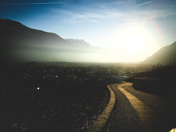 Beauty In Nature City Day Direction Environment Landscape Mountain Mountain Range Nature No People Outdoors Road Scenics - Nature Sign Sky Sunlight Symbol The Way Forward Tranquil Scene Tranquility Transportation
