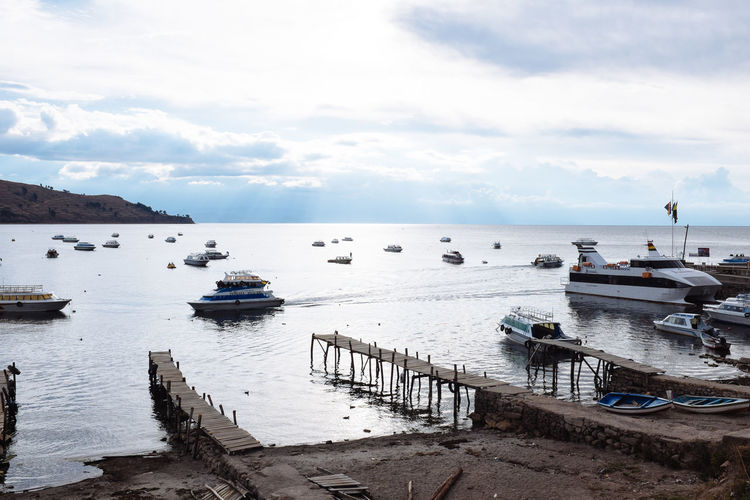 Astrology Sign Beauty In Nature Bolivia Cloud - Sky Copacabana Day Harbor Horizon Over Water Idyllic Moored Nature Nautical Vessel No People Outdoors Scenics Sea Sky Titicaca Lake Tranquil Scene Tranquility Transportation Water Yacht