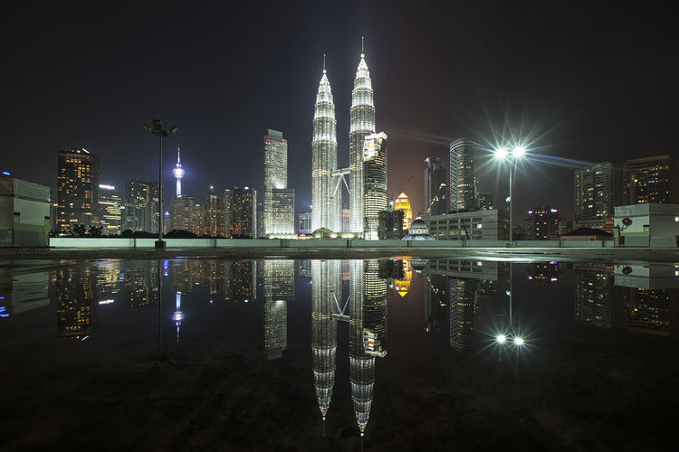 KLCC reflection after raining. Reflection City Night Architecture Travel Destinations Skyscraper Travel Sky Business Finance And Industry Urban Skyline Cityscape Illuminated Downtown District Modern Built Structure Water Building Exterior Outdoors Vacations Twintowers