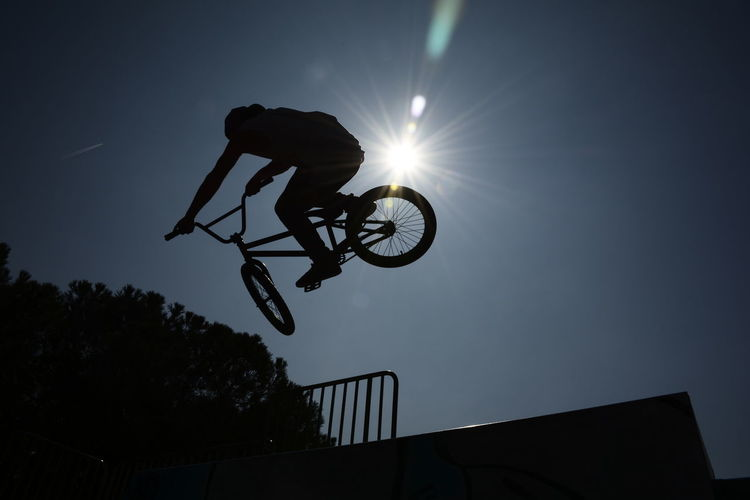 Freestyle biker Sport Low Angle View Competitive Sport Skill  Bicycle Freestyle Biking Freestylebmx Bmx Cycling Skateboard Park Shadow Silhouette Cycling Freestyle Freestyle Sports Low Angle View Riding Extreme Sports Sportsman Silhouette Exercising Outdoors Welcome To Black