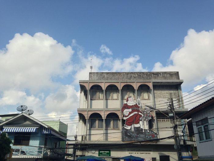 Santa on building Santa On Building Attach Christmas New Year Community Red Santa Seasoning Old Building  Saint Francis Church Bangkok Blue Sky Spotted In Thailand The Architect - 2016 EyeEm Awards
