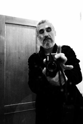 Yo mismo. B/w. Blackandwhite Photography monochrome photography Canonphotography Canong7xmarkii Human Hand Men Beard Senior Adult Camera Self Portrait Photography
