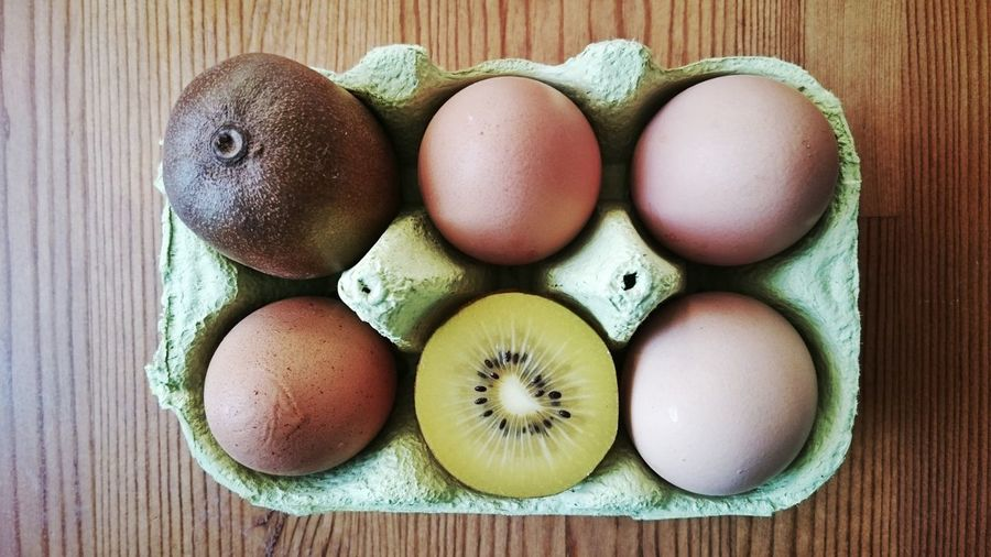 There is something wrong with the eggs, isn't it?! ;-) Wood - Material Healthy Eating Food Group Of Objects Food And Drink Freshness No People Egg Carton Indoors  Close-up Day Egg Kiwi Kiwifruit Arial View Pattern Things Organized Neatly View From Above Looking Down Food And Drink Eggs For Breakfast Fruit EyeEm Diversity