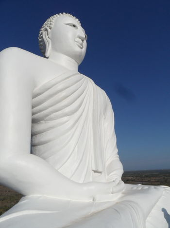 Great Buddha statue, beautiful 💕 Big Statue Buddha Statue Buddhism Cultures Day EyeEm Best Shots Low Angle View No People Outdoors Religion Sculpture Spirituality Sri Lanka Statue White Color Mantra Om Mani Padme Hum Themple