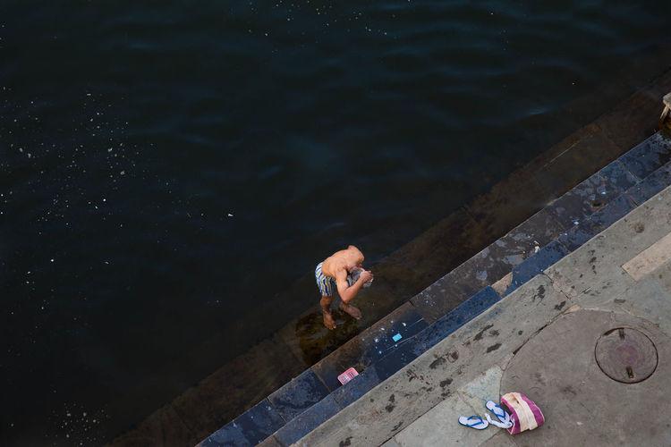 High angle view of man bathing at riverbank