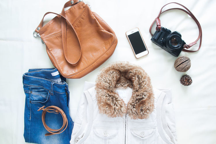 Woman clothing accessories with smartphone and camera on white background, Travel concept Bag Camera Chic Cloth Clothing Day Device Fashion Fashion Indoors  Jacket Jeans Leather Mobile No People Portable Information Device Smart Phone Technology Travel Women