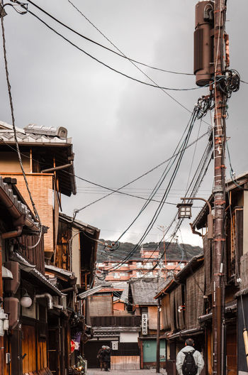 geisha district Architecture Building Exterior Built Structure Cable Complexity Connection Day Electricity  Electricity Pylon Geisha District Gion Kyoto Low Angle View No People Outdoors Power Line  Power Supply Sky TCPM Technology Telephone Line