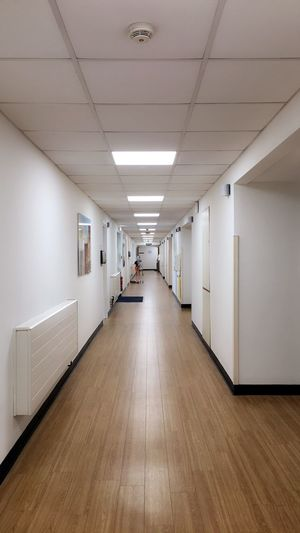 Private Hospital Corridor Chelmsford Essex NHS Hospital Long Way Down Looking Down Surgery Quiet Dead Medical Blood Pressure England Private Hospital Modern Lights Down The Middle Nhs Hospital Symmetrical Indoors  Corridor Architecture The Way Forward Illuminated No People