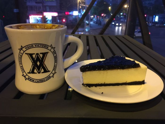 Coffee And Sweets Cheese latte and blueberry cake in Korean shopping area