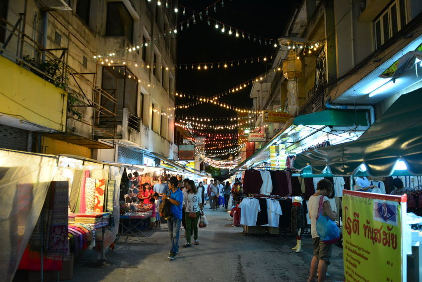 Architecture Bazaar Built Structure Casual Clothing Chiang Rai, Thailand City City Life Diminishing Perspective Group Of People Illuminated Leisure Activity Lifestyles Market Market Stall Men Night Night Bazaar Outdoors Retail  Store The Way Forward