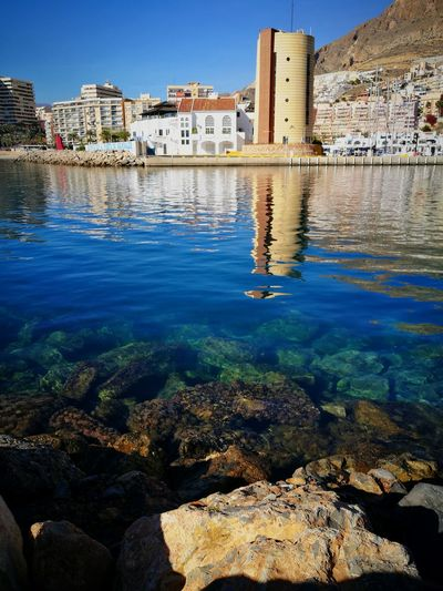 Reflejo Aguadulce Almería Southernspain Sea Mediterranean  Harbor Reflection Sun Water Outdoors Building Exterior Clear Water Built Structure Apartment Residential Building Outdoors Day No People Sky