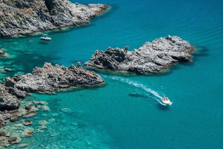 High angle view of boat in calm blue sea