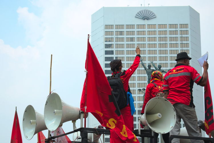 May Day march in Jakarta. Day Demonstration Flag Labor Labor Day Large Crowds Large Group Of People March Marching May Day Men Outdoors Parade People Protest Protesters Real People Red Riot Uniform Walk Wealth The Photojournalist - 2017 EyeEm Awards