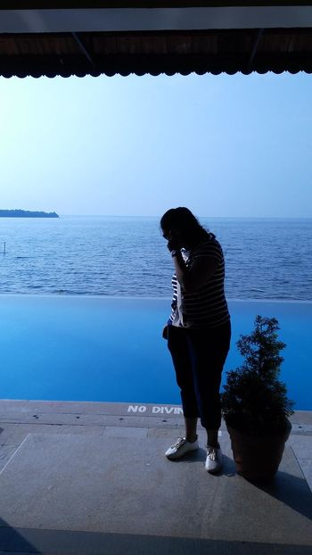 Sea One Person Adult Standing Water Outdoors Blue Sky Full Length Sunlight Selective Focus Plant Small Island Shaded Blue