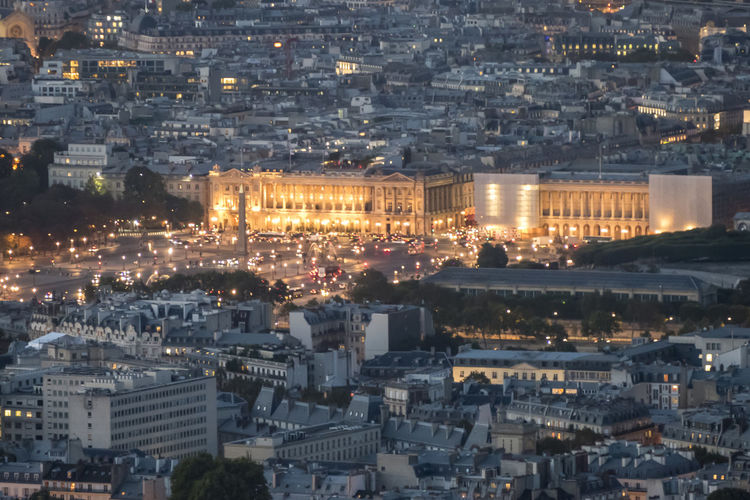 Aerial view of paris at dusk with the city illuminated