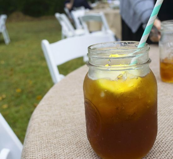 Close-up of ice tea in jar on table