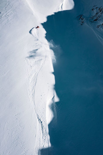 High angle view of man skiing on snow