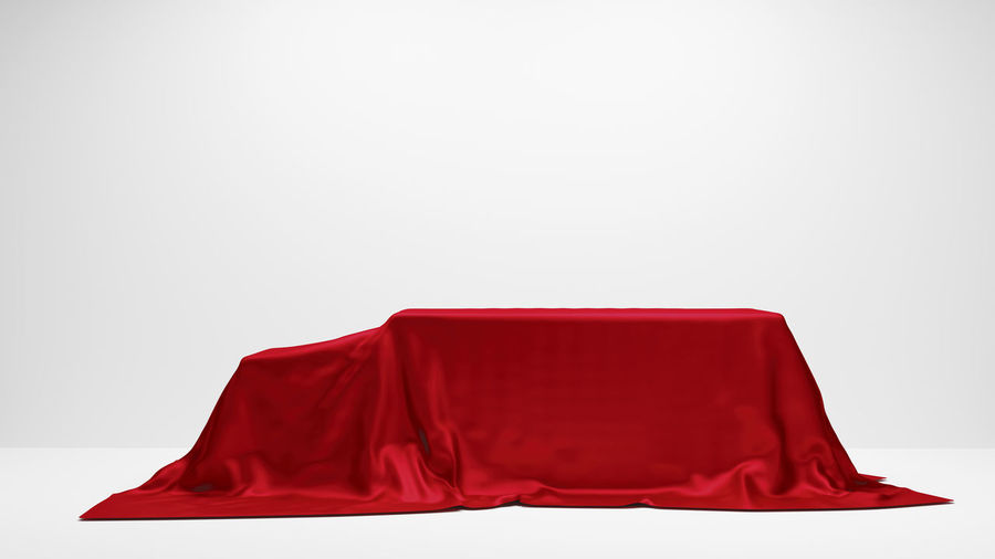 Red empty chair against white background