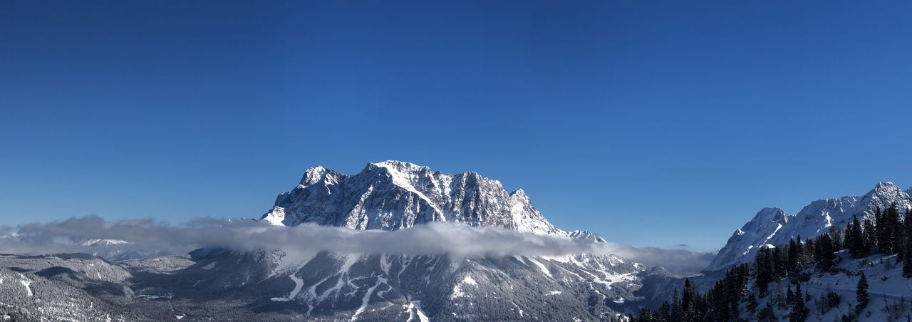 View of snowcapped mountain against blue sky