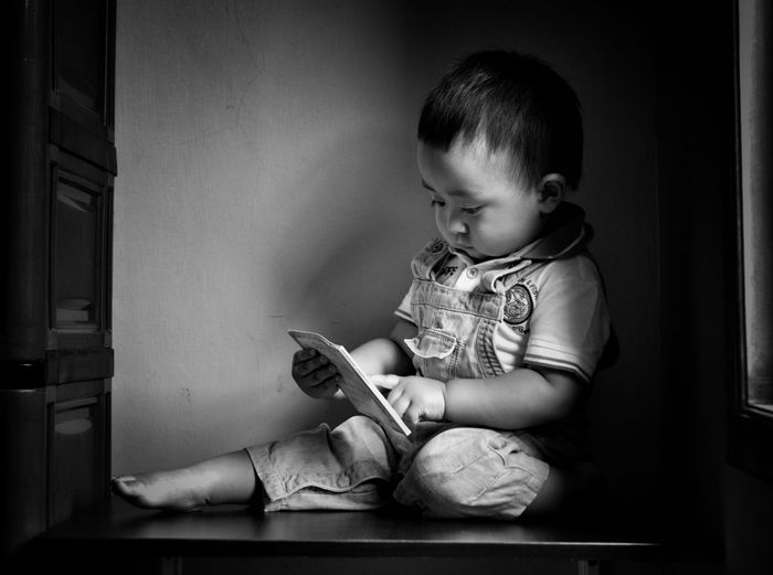 Reading... Baby Babies Only Sitting One Person Innocence Looking Down Book Cute Blackandwhite Babyhood Childhood Indoors  Full Length The Week On EyeEm EyeEm New Here Kids Babyboy Bw Fresh On Market 2017