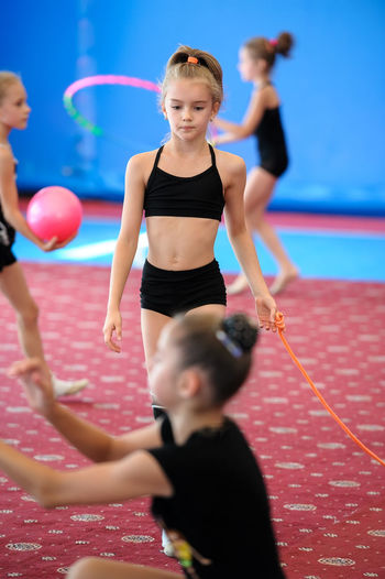 Athlete Caucasian Child Female Girl Group Gymnast  Gymnastics People Sportsman Stretch Student Teenager