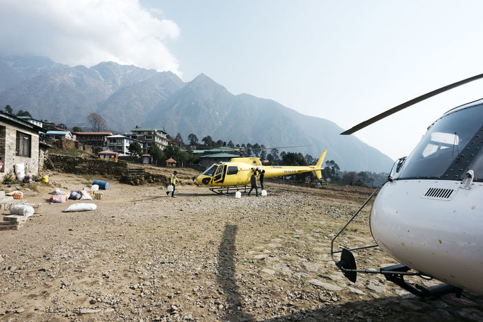 Lukla Airport, helicopter parking. Helicopter The Week on EyeEm Air Vehicle Airfield Airplane Architecture Building Exterior Built Structure Cloud - Sky Day Environment Land Men Mode Of Transportation Mountain Mountain Range Nature Outdoors People Public Transportation Sky Transportation Travel