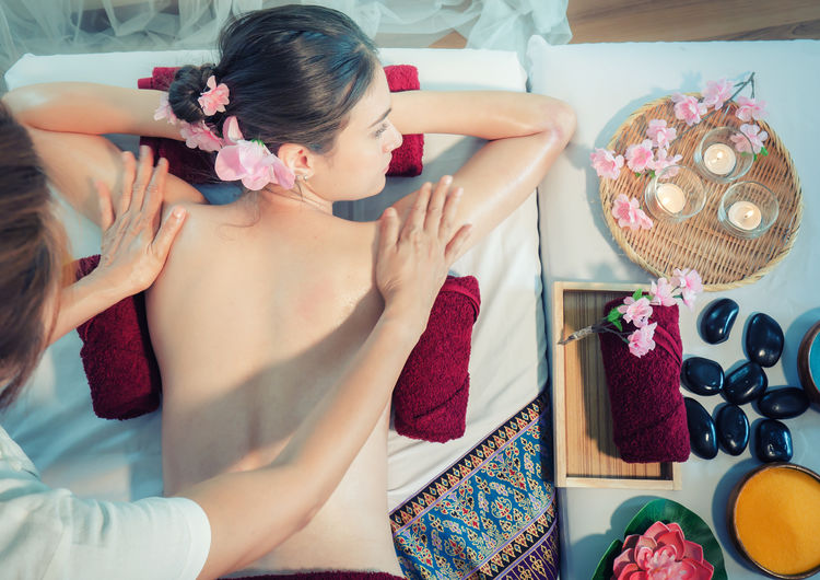 Aromatherapy Body & Fitness Relaxing Woman Adult Beautiful Woman Flower Flowering Plant Hairstyle Indoors  Leisure Activity Lifestyles Massage Therapy Professional Real People Spa Center Spa Treatment Treatment Women Young Women