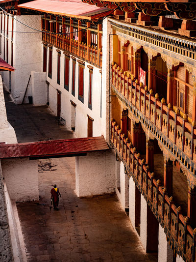 A monk walking across the hallway at the monastery. Travel Destinations Temple Temples Monks Buddhism Bhutan Monastery