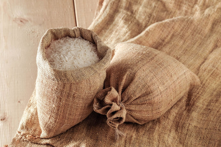 Art And Craft Brown Burlap Close-up Clothing Floral Pattern Food Food And Drink High Angle View Indoors  Jute Material No People Pattern Sack Softness Still Life Sweater Textile Wood - Material Wool